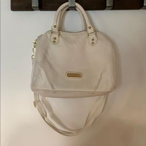 White Steve Madden purse with pink interior